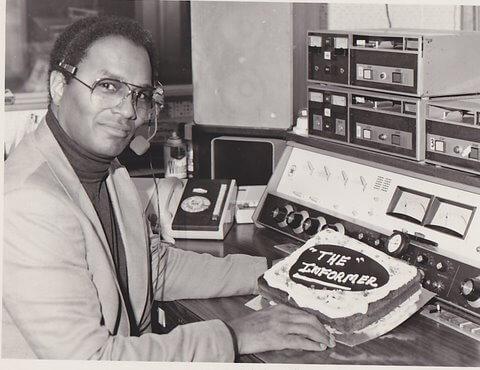 fil fraser in a broadcasting booth, with a cake that says