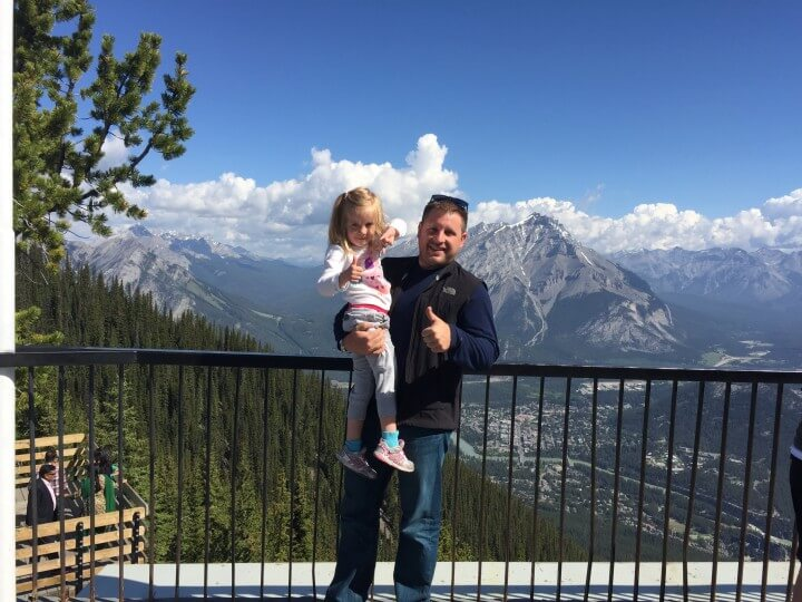 greg with kid in mountains