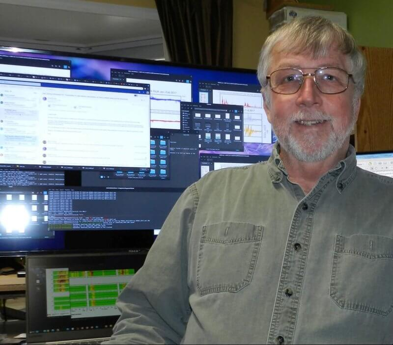 Dr. Martin Connors in front of a computer.