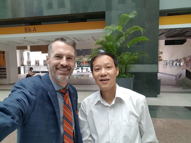 Dr. Neil Fassina met with AU alumnus Dr. Sze Kiu Yeung March 1 at the Singapore University of Social Sciences.