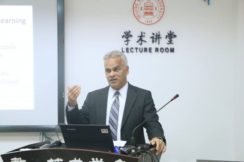 Dr. Mohamed Ally, an internationally respected scholar from Athabasca University, giving a presentation in China.