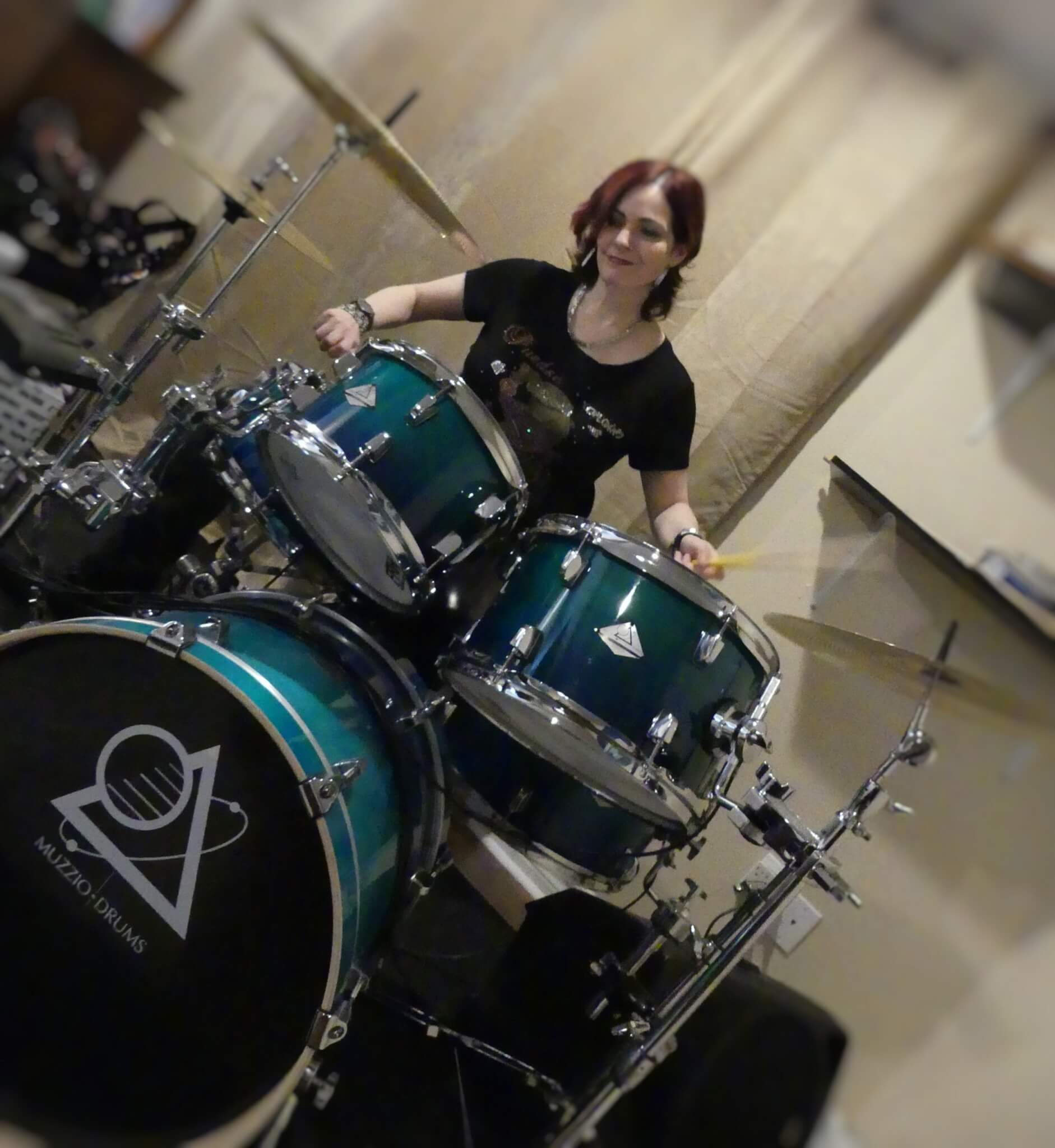 Cindy Goldberg playing drums
