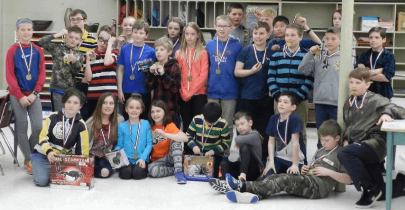 Some of the participants of a science fair at Landing Trail School. Science Outreach – Athabasca judged the projects and donated the prizes. Photo: Wayne Brehaut.