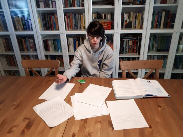 Jonny Aloni, 14, works on his university-level math courses at his home in Metro Vancouver.
