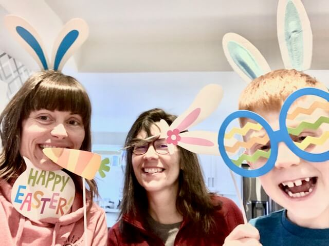 Tracey and her son wearing bunny ears for Easter with a friend standing between them