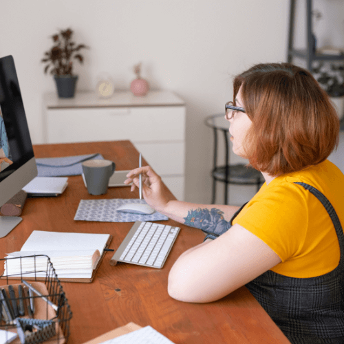 Woman on computer with another person on the screen