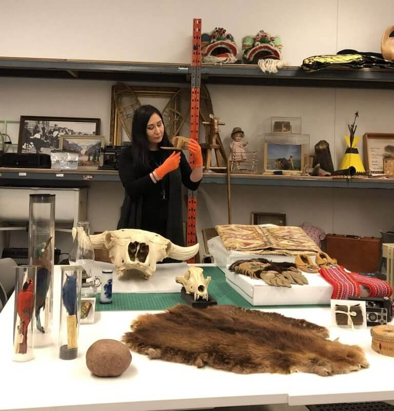 Eleonora Sermoneta surrouded by artifacts at the Royal Albert Museum