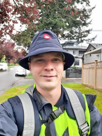 A selfie of Adam Lee wearing his Canada Post uniform while delivering the mail