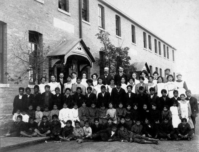 Residential school group photograph, Regina, Saskatchewan, 1908. Photograph Source: John Woodruff – Public Domain.